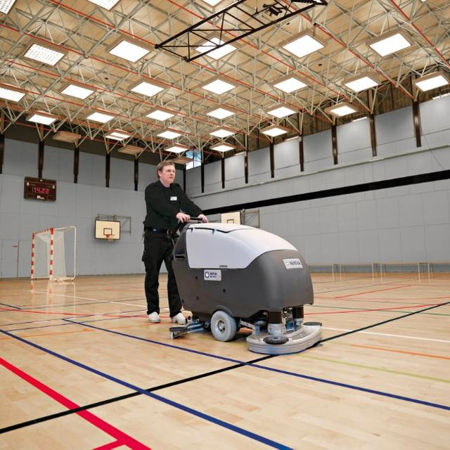 Nilfisk BA851 scrubber dryer cleaning gymnasium